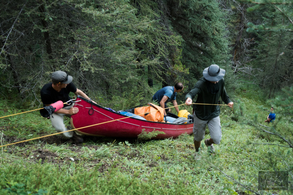 Lowering Canoes Down a Steep Bank
